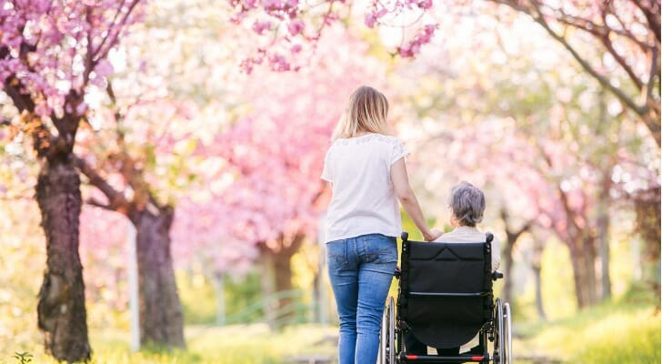 elderly woman in a wheelchair outside